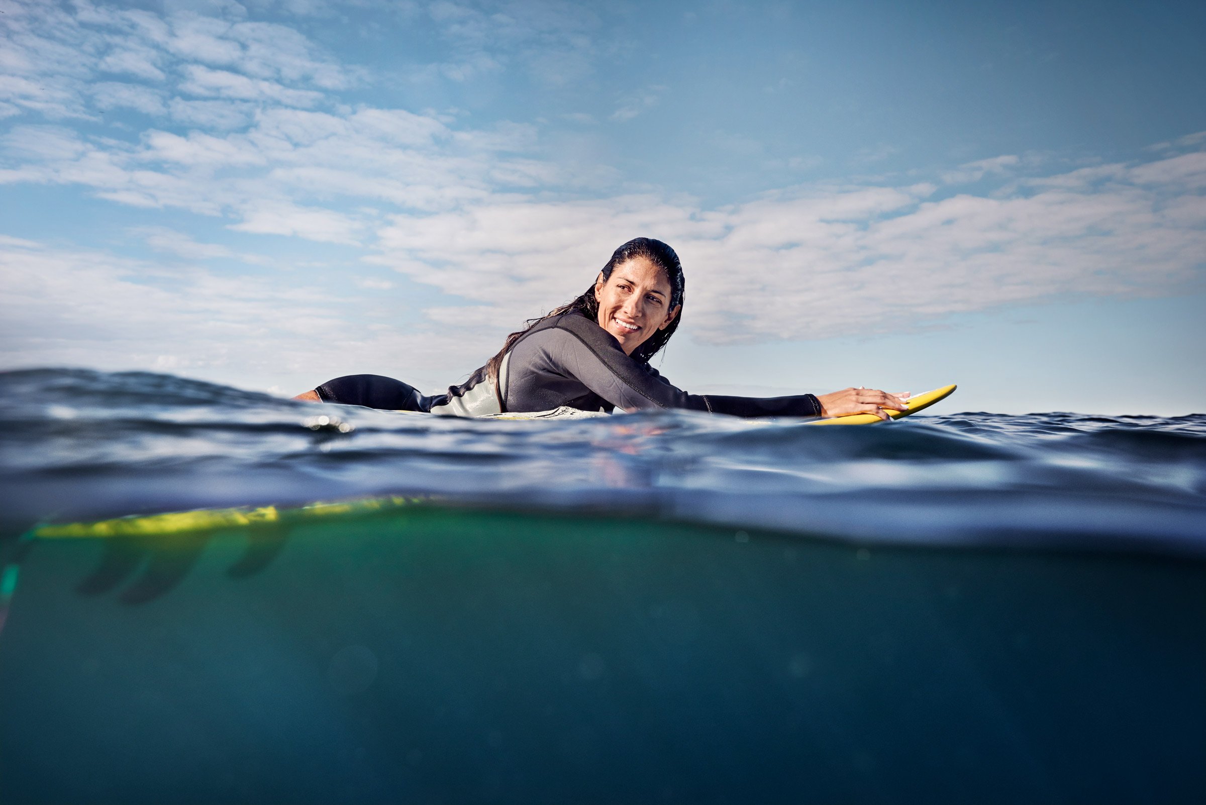 Surfers_Woman-Paddling-on-Surfboard_Abbott_4364_v3